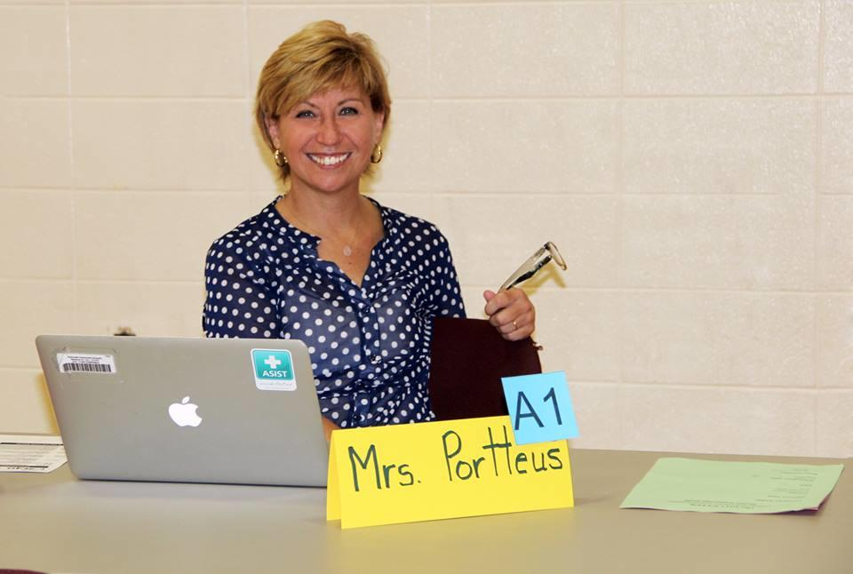 Mrs. Portteus ready to help seniors with their transcript audits.