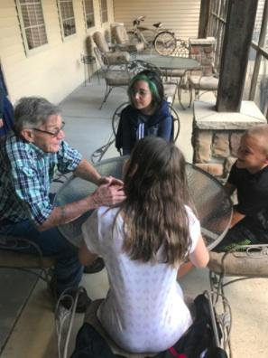 Riverside students talking with a resident