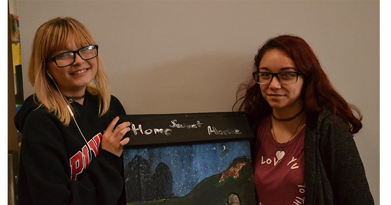 WSOI students holding the bat house they painted.