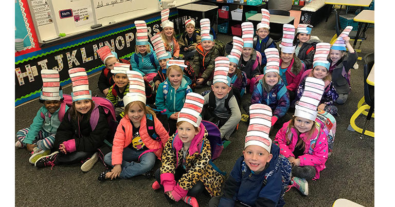 Menominee Students dressed up in Dr. Seuss hats.