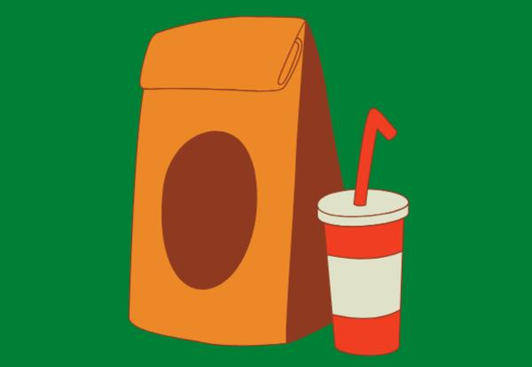 Lunch sack and beverage with straw on green background