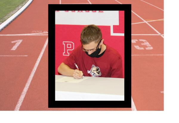 Nick Anders signing photo on black rectange and track image