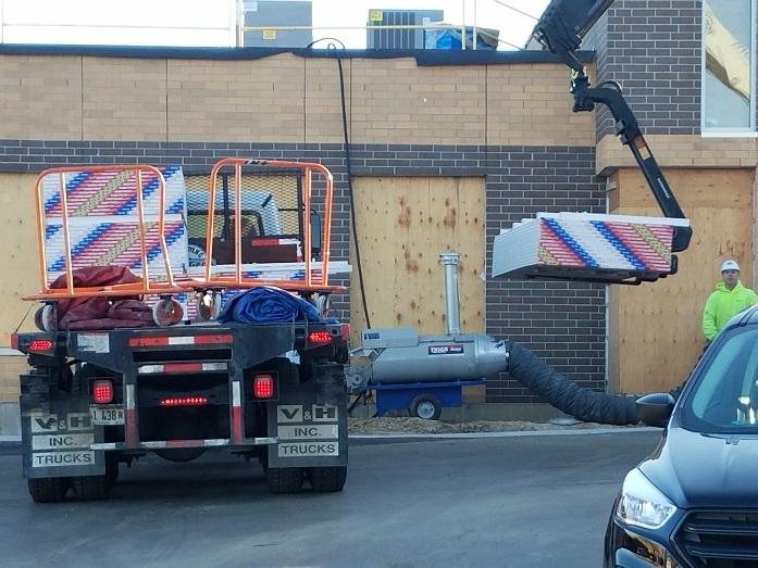 Delivery of building materials for the inside of the building.