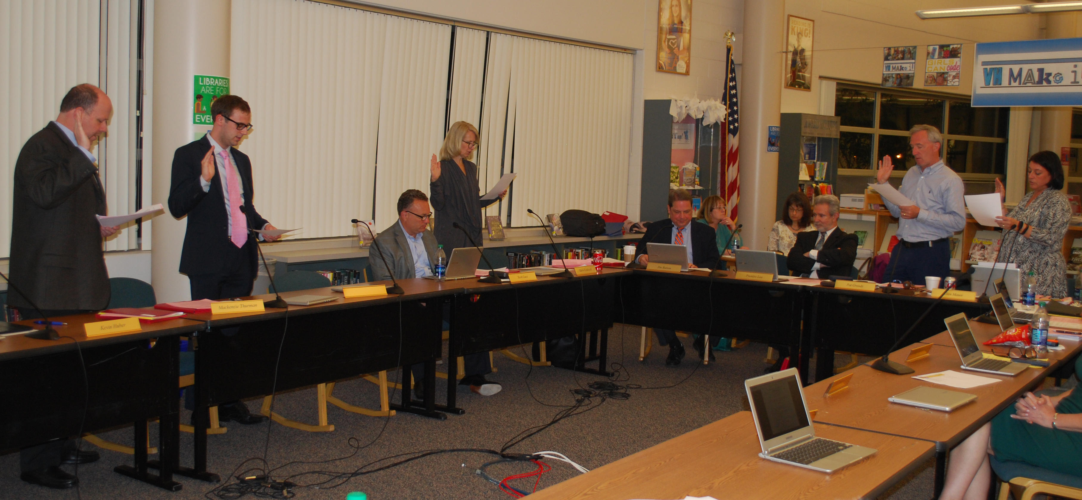 New Board of Education Members being sworn in at their first board meeting.
