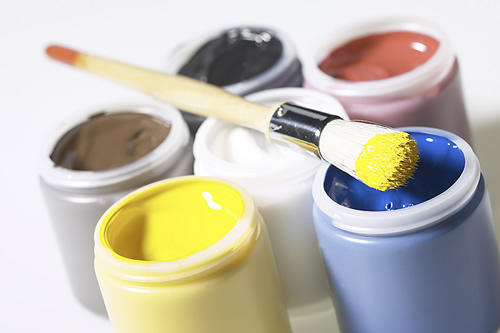 paint cans with a paint brush