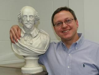 Dr. Reiff with bust of Shakespeare