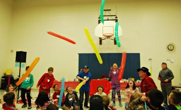 Students play with balloons during the Camp Douglas Math and Science Night