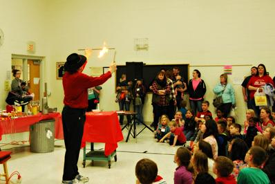 Students watching a fire demonstration in the gym