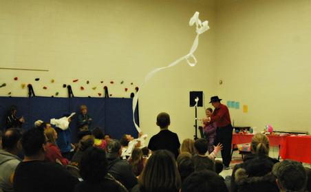 A streamer floats through the air during a math and science demonstration