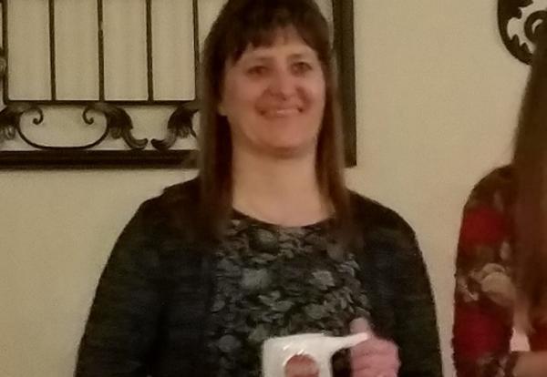 Karen Brown receiving her award