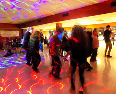 Students dancing under colored lights