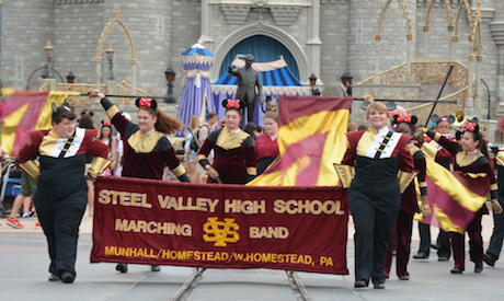 Steel Valley band members dressed as Minnie Mouse during performance