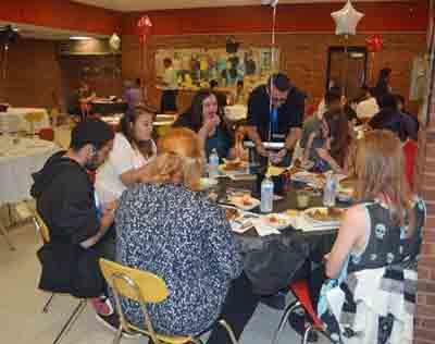 Table of students enjoying breakfast