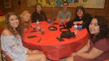 Senior students at a red table