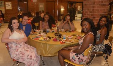 Smiling seniors at table