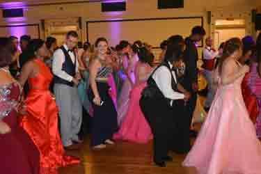 Line dancing on dance floor