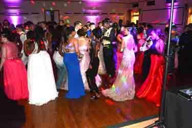 Girls in elegant dresses on dance floor