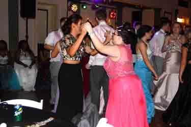 Two friends dancing on floor