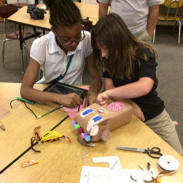 Students work on hummingbird kit