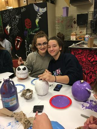 Two students painted pumpkins like Jack Skellington