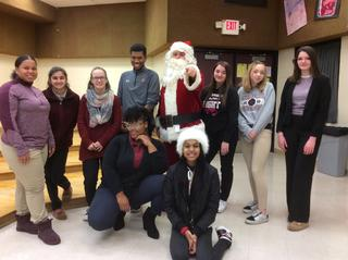 Santa poses with students