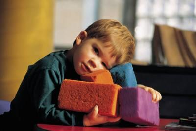 boy hugging a sponge