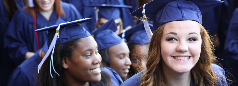 photo of girl in blue regalia in graduation line