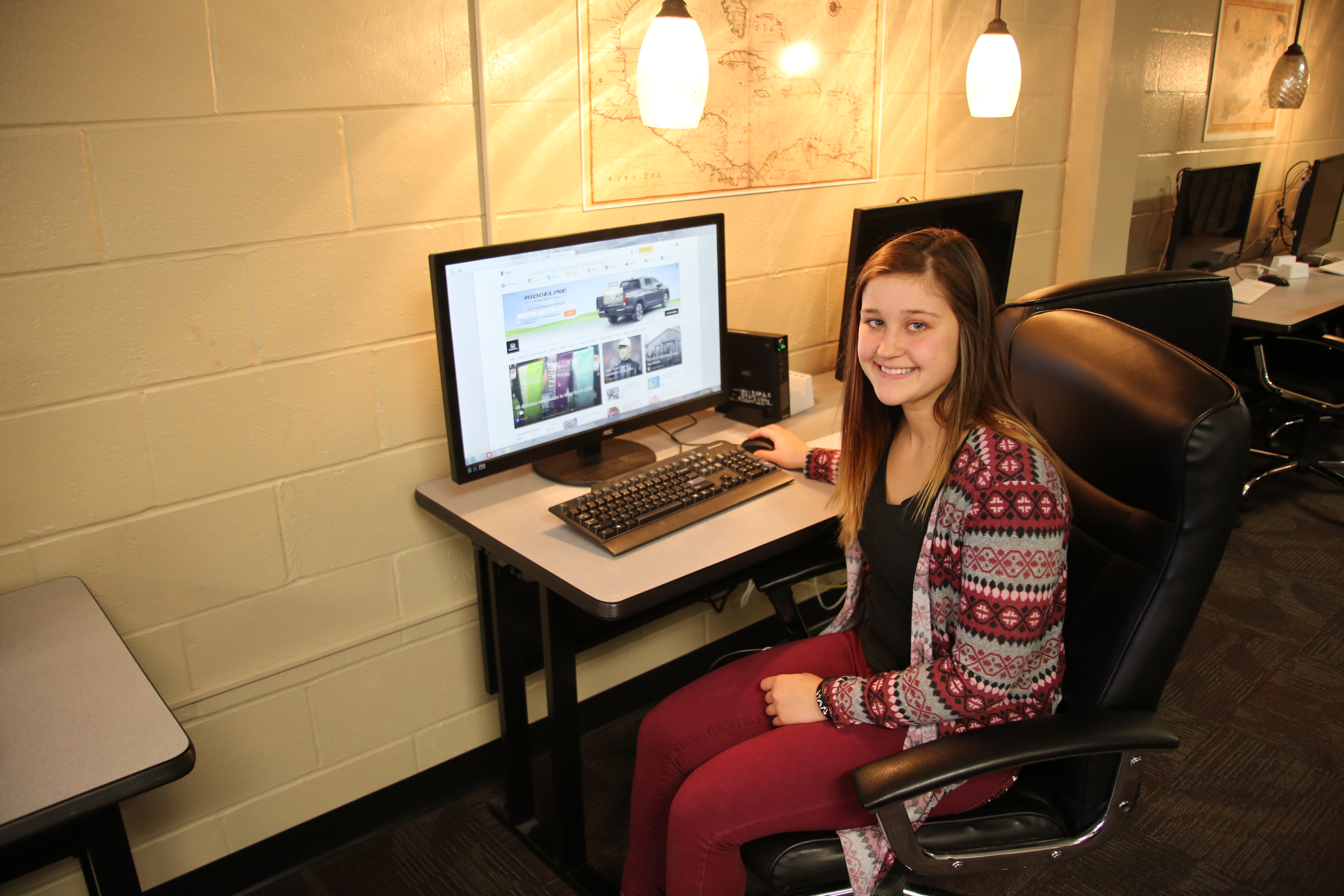 Student with a desktop computer