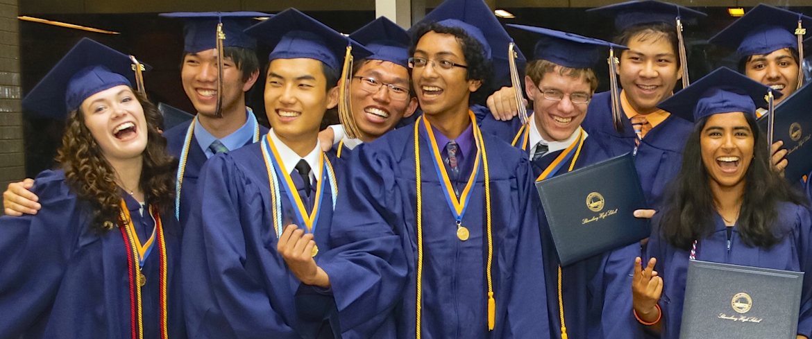 Photo of students with diplomas at graduation