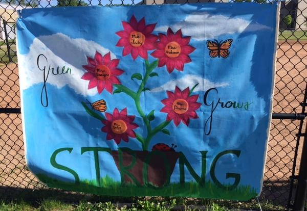 """red flowers on a blue cotton banner with the word """"Strong"""""""