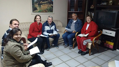 In spring 2017, members of the Igreja Evangélica Menonita de Curitiba congregation gather for the Raízes course that Bob Gerber initiated with an advisory group from the Brazilian Mennonite Church. From left, Karina and Herbert Buhr; Tania and João Buhr (associate pastor and facilitator); and Marcelo and Waltraud Nicco. (Photo provided)