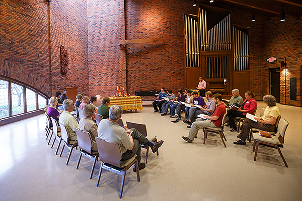 Faculty, staff and students use the Anabaptist Prayer Book during a time of weekly worship.