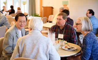 Jonah Yang, a Master of Arts in Christian Formation student from Cottage Grove, Minnesota; visits with Eleanor Kreider of Goshen, Indiana; and Kevin and Sharon Yoder, co-pastors of Olive Mennonite Church in Elkhart. Sharon is also a Master of Divinity student. (Credit: Jason Bryant)
