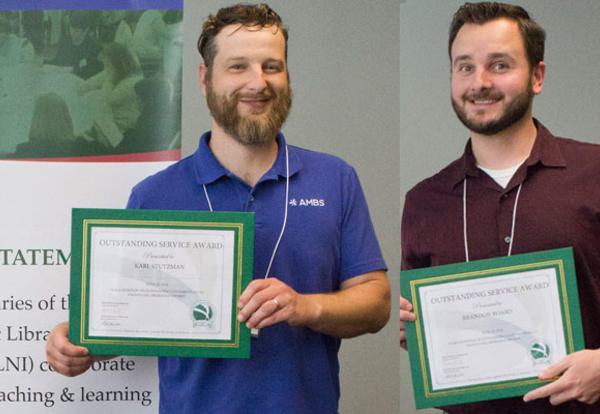 Library Director Karl Stutzman and Librarian Brandon Board receive Outstanding Service 2018 awards from Private Academic Library Network of Indiana (PALNI).