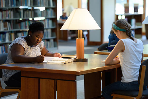 As part of their Group Experience, !Explore participants use resources from the AMBS Library to research a theological question they have chosen to focus on during the summer program. Pictured are Linda Moyo (at left) and Sasha Dyck. (Credit: Jason Bryant)