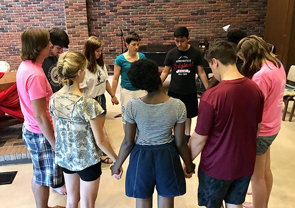 During their Group Experience on the AMBS campus, !Explore participants learn from seminary faculty about practical ministry skills. Here, participants pray with Rachel Miller Jacobs, D.Min. (center, in blue), associate professor of congregational formation. (Credit: Jason Bryant)