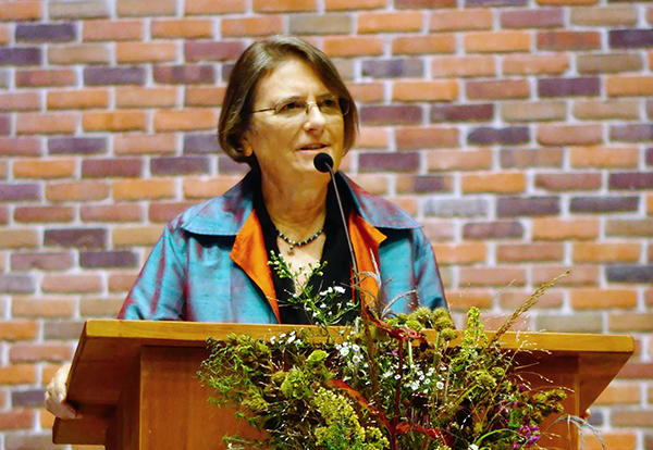 Sara Wenger Shenk, Ed.D, greets participants at AMBS's Rooted and Grounded Conference on Land and Christian Discipleship on Sept. 27, 2018. (Credit: Perdian Tumanan)