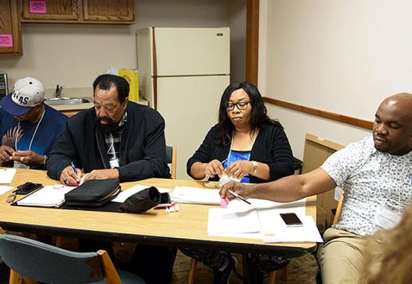 Anthonia Onye of Los Angeles Faith Chapel (third from left) talks with her mentees — (l. to r.) Raymond (Andrew) Arnold and Claude Flowers of Family Mennonite Church in Los Angeles, and Hilarion (Chidi) Ihezuoh of Los Angeles Faith Chapel — during an exer