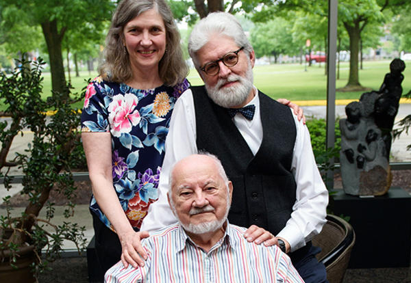 Bill Klassen (in front) is pictured with his son and daughter-in-law, J. Tyler Klassen (MACF 2017) and Mary E. Klassen, former AMBS Director of Communications, at Tyler's graduation from AMBS in 2017. (Credit: Jason Bryant)