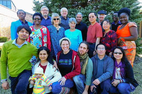 Participants in the Compassionate Care seminar at AMBS included (front, l. to r.) Pratik and Shabnam Pratik Bagh of India, and their child; Rianna and Benjamin Isaak-Krauss of Canada and Germany, respectively; Ger Her and May Yang of Thailand and Minnesota; (back, l. to r.) Amos and Esther Butendeli Muhagachi of Tanzania; David B. Miller; Rhoda Keener; Don Neufeld, an observer from Mennonite Men Canada; Carolyn Heggen; Steve Thomas, an observer from Mennonite Men U.S.; Jonah Yang of Thailand and Minnesota; Mike Sherrill, an observer from Mennonite Mission Network; Memee Yang of Thailand and Minnesota; and Patrick and Pamela Obonde of Kenya. Not pictured: Cyneatha Millsaps, Mennonite Women USA Executive Director. (Photo provided)