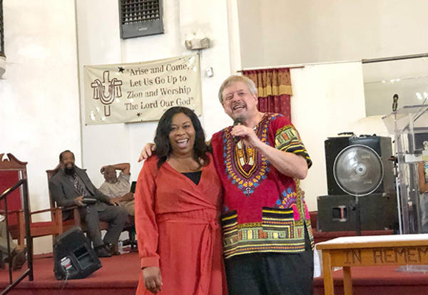 Anthonia Onye, Pacific Southwest Mennonite Conference Regional Minister for Southern California, and David B. Miller, Teaching Associate for the AMBS Church Leadership Center, illustrate the idea of breaking down the wall of hostility (Ephesians 2:14) dur