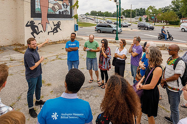 Incoming students visit the Kelby Love Violence Intervention Project mural on the corner of Prairie and Main streets in Elkhart, Indiana. Credit: Peter Ringenberg