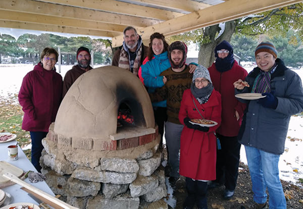 A cold and snowy day in November was the perfect time to fire up AMBS's new cob pizza oven, a gift of the Class of 2019! This group learned how to use the oven to make personal pizzas. The oven is made of a mix of clay, sand and organic matter and is loca
