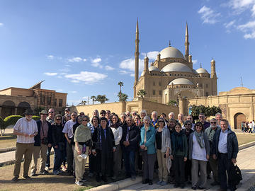 "Participants in AMBS's ""Encountering Egypt"" learning tour at the Salah El Din Citadel (ca. 12th century) in Cairo; in the background is the Mosque of Muhammad Ali (19th century). (Credit: Safwat Marzouk)"
