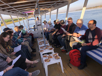 "Participants in AMBS's ""Encountering Egypt"" learning tour sing together on a felucca ride, enjoying fellowship on the beautiful Nile River in Upper Egypt. (Credit: Safwat Marzouk)"