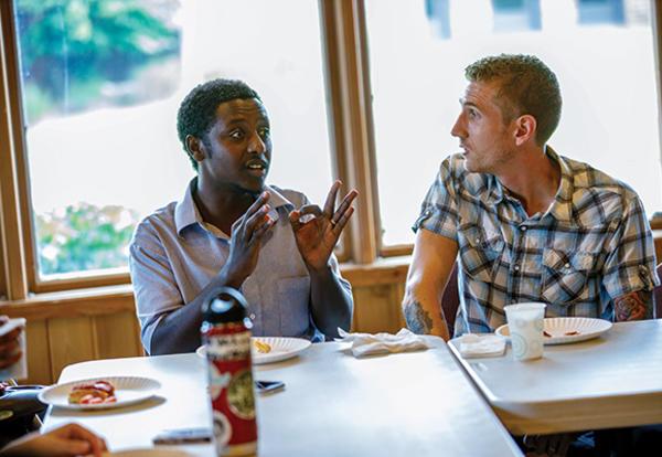 Henok Mekonin of Nazreth, Oromiya, Ethiopia, an MA: Theology and Peace Studies student and MATGA Ethiopia Assistant, talks with MDiv Connect student Josh Landis of Souderton, Pennsylvania. (Credit: Peter Ringenberg)