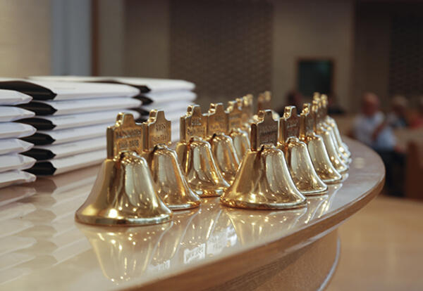 During Anabaptist Mennonite Biblical Seminary's annual commencement ceremony, graduates receive small replicas of the bell that is on the seminary campus, which originally hung at the Wadsworth (Ohio) Institute, the first Mennonite institution of higher l
