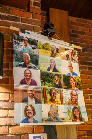 A composite image of the 15 candidates for graduation at Anabaptist Mennonite Biblical Seminary in Elkhart, Indiana, was positioned beneath the webcam for the speakers at the commencement service at AMBS.