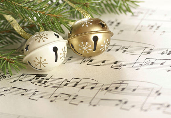 sheet music with holly and bells