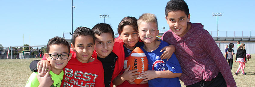 photo of a group of boys on football field